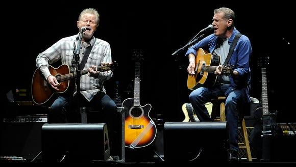 Eagles' musicians, Don Henley and Glenn Frey, perform