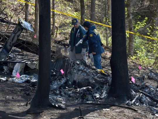 NTSB investigators on scene of a fatal helicopter crash Tuesday, April. 5, 2016.  (MICHAEL PATRICK/NEWS SENTINEL)