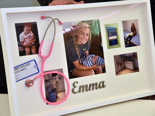 A memory board of Emma Walker put together by her parents Jill and Mark Walker is displayed at East Tennessee Children's Hospital on Monday, March 20, 2017. Emma's family was attending the dedication of a room in the a NICU in her memory.