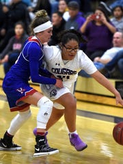 Spanish Springs' Autumn Wadsworth dribbles past Reno's