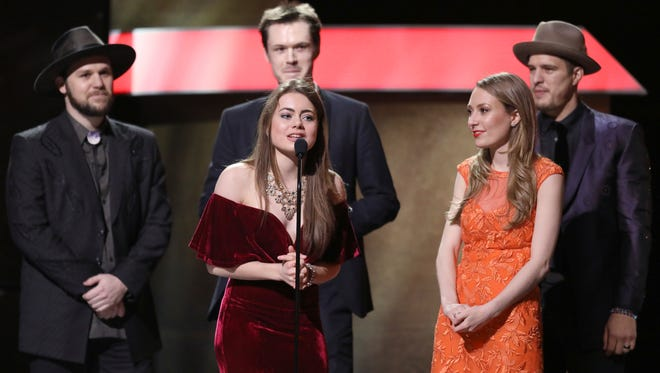 """The O'Connor Band accepts the award for Best Bluegrass Album for """"Coming Home"""" at the 59th annual Grammy Awards on Feb. 12, 2017, in Los Angeles."""