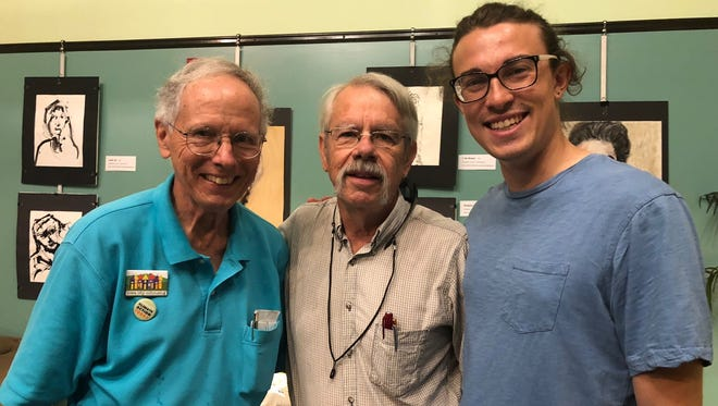 From left, Del Holland and Craig Mosher of Prairie Hills, and Ryan Hall of the River City Housing Collective.