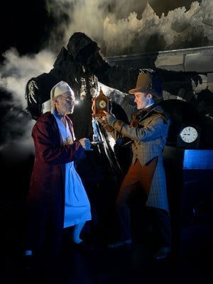 """Special to the News Journal Richard Pait as Scrooge, left, the Spirit of Christmas Future ?as himself? and Tim Colee as Mr. Marvel in the University of West Florda production of """"A Christmas Carol."""""""