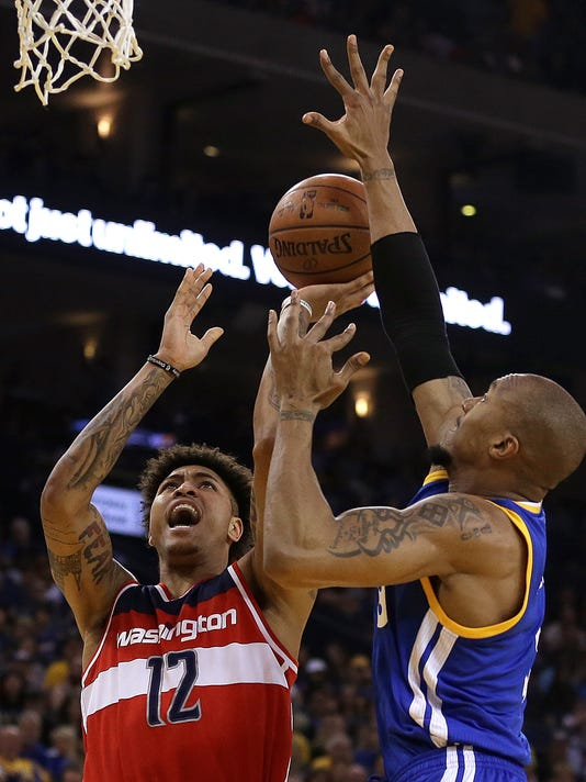Washington Wizards' Kelly Oubre Jr. (12) shoots against Golden State Warriors' David West during the first half of an NBA basketball game Sunday, April 2, 2017, in Oakland, Calif. (AP Photo/Ben Margot)