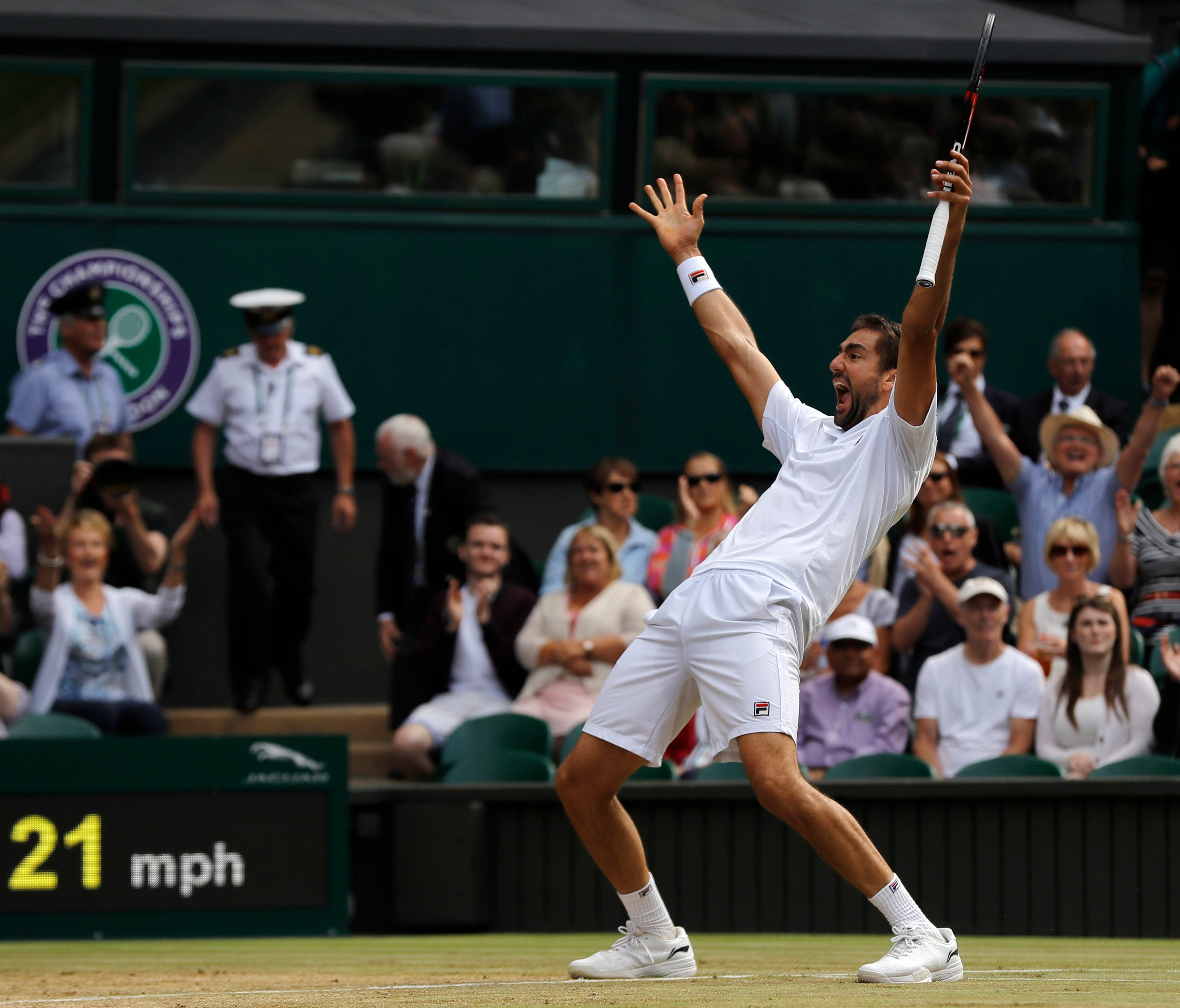 Croatia's Marin Cilic celebrates after beating Sam Querrey of the United States at the end of their semifinal match on day eleven at the Wimbledon Tennis Championships on July 14.