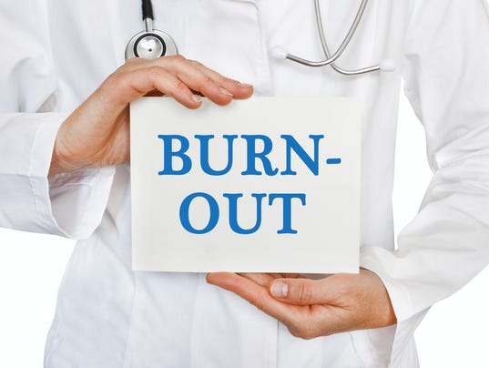 Burn Out card in hands of Medical Doctor