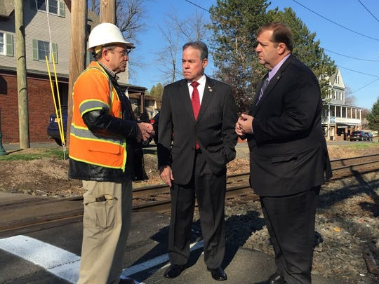 Rockland County Highway Deputy Superintendent Andy Connors talks with County Executive Ed Day and Clarkstown Town Supervisor-Elect George Hoehmann on Wednesday about the Lake Road rail crossing in Congers.