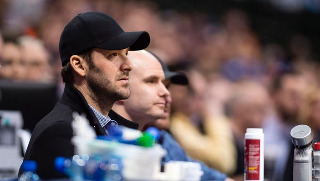 Dallas Cowboys quarterback Tony Romo (black hat) watches a game between the Dallas Mavericks and the New York Knicks at the American Airlines Center earlier this season.