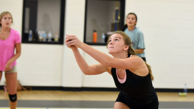 Oak Grove volleyball player Rhyan Plumlee passes the ball over during a practice drill on Wednesday.
