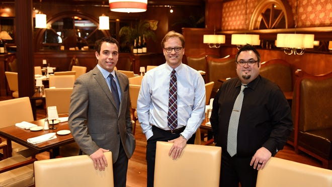 Michael Gjernes, Ken Bashore and Tim Meagher are the new owners of Minervas and Grille 26.