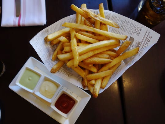 French fries with sauce verte, aioli and truffle ketchup