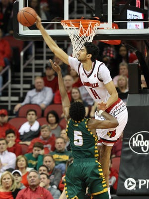 Louisville's Anas Mahmoud blocks a shot by George Mason's Jaire Graver during first half action. Nov. 12, 2017.