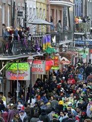 Bourbon Street in New Orleans during Mardi Gras.