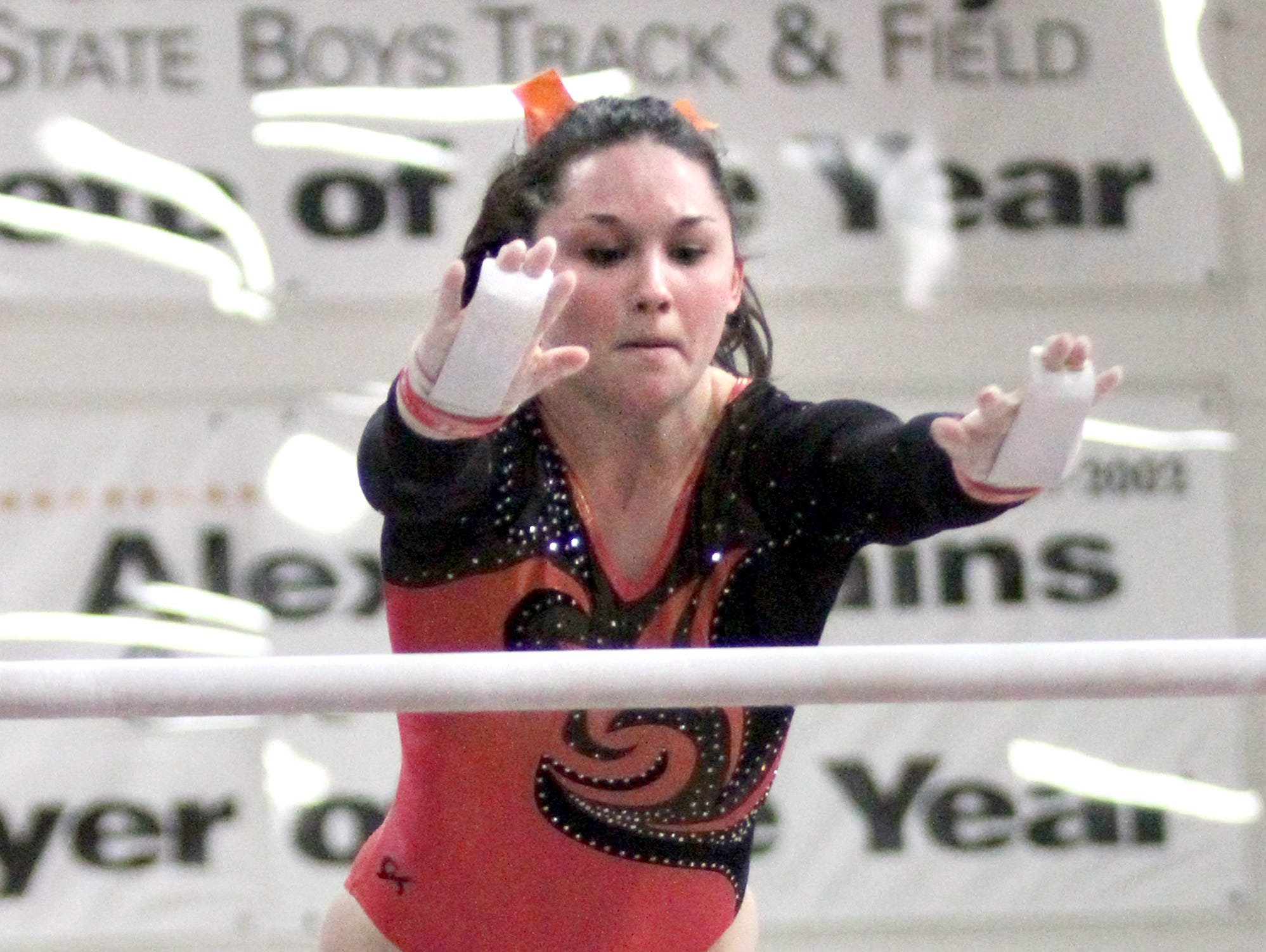 Marshfield High School's Olivia Tierney performs on the uneven bars during the WIAA Division 1 Sectional Gymnastics Meet on Saturday in Stevens Point.
