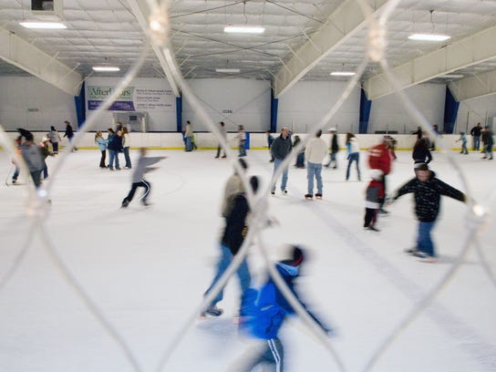 Children and their parents enjoy open skating at Lakeshore