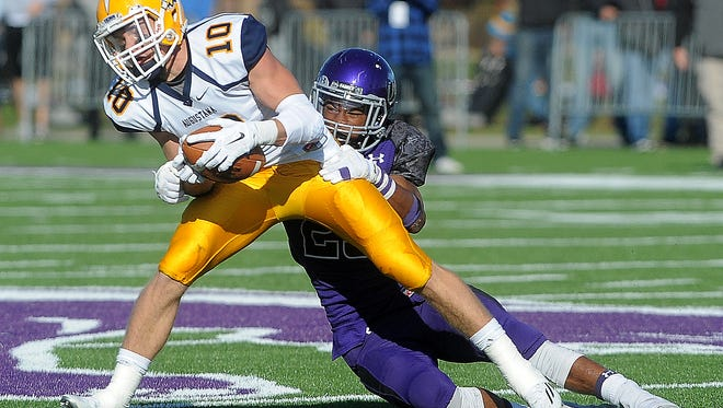 University of Sioux Falls' Josh Butler takes down Augustana University's Charlie Hayes during their game at Bob Young Field on Saturday, Oct. 24, 2015.
