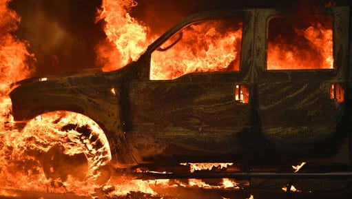 A truck burns on Main Street in the town of Lower Lake, Calif. on Sunday.