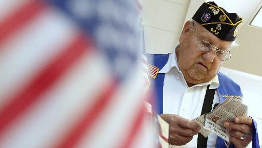 Frank Hernandez Jr., a Korean War Veteran, visits the Nueces County Veterans Services booth during the 2011 Coastal Bend Veterans Summit at Del Mar College. The focus of the summit is to assist veterans and service members with obtaining information about benefits, employment, education, housing and legal services.