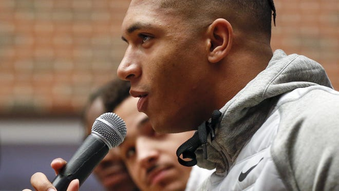 OSU running back  Chuba Hubbard speaks as wide receiver Tylan Wallace looks on during an OSU football pep rally in the Student Union at Oklahoma State University in Stillwater, Okla., Tuesday, Jan. 21, 2020. [Nate Billings/The Oklahoman]\r