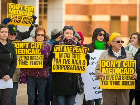 Protesters gather outside the Neil Smith Federal Building in downtown Des Moines Wednesday, Nov. 29, 2017, to protest the Republican Tax Reform Plan.