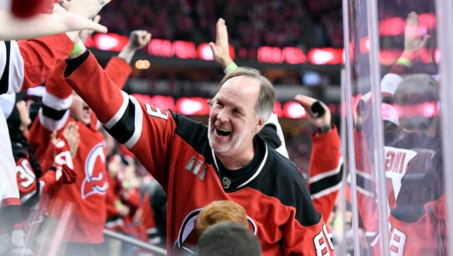 Devils fans react as Stefan Noesen's goal puts the Devils 3-2 over the Lightning in the third period. The Devils defeat the Lightning 5-2 in Game 3 of Round 1 of the Stanley Cup Playoffs at the Prudential Center in Newark, NJ on Monday, April 16, 2018. The series is 2-1, Tampa Bay.