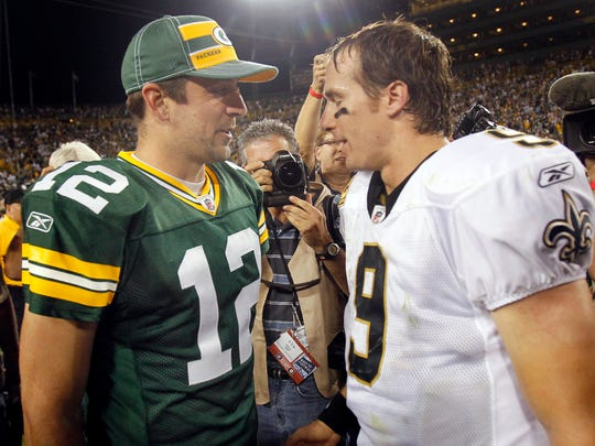 Packers quarterback Aaron Rodgers and New Orleans Saints quarterback Drew Brees following their 2011 season opener at Lambeau Field.