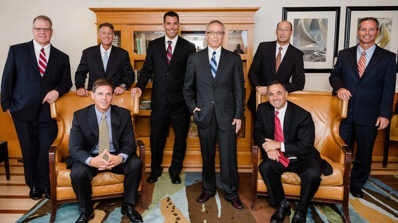 Standing from left to right: Mark A. Welsh, CPA, MBA; Craig A. Walter, CPA; Roy J. Geiser, CPA; Charles M. Meenehan, CPA, MST, CVA; Ronald W. Hickman, CPA; and Chris A. Hall, CPA, CFE. Sitting from left to right: Corey N. Duncan, CPA, MBA, CGMA and Herbert J. Geary III, CPA, CGFM.