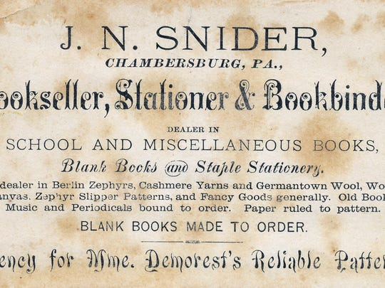 J.N. Snider Bookseller and Bookbinder's trade cards advertised its books, postcards, and the wide variety of stationary.