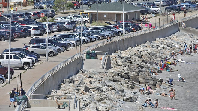 The DCR parking lot on Nantasket Beach. Hull which some town officials would like to cut capacity in half.  Wednesday August 12, 2020 Greg Derr/The Patriot Ledger
