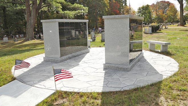 New work at the Cudworth Cemetery in Scituate which the town claims is sub standard and is in over payment on Tuesday October 27, 2020  Greg Derr/ The Patriot Ledger