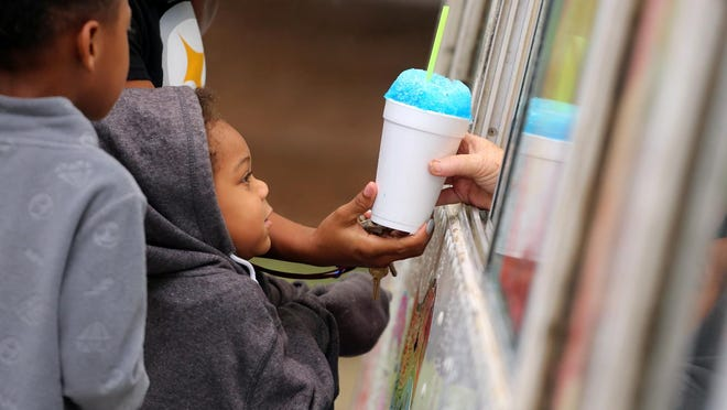 Avyana Miller, 4, orders shaved ice at Food Truck Thursday at the LeGrand Center.