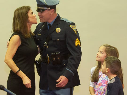 Mary Anne Wolf  congratulates her husband Lt. Leonard Wolf ,next to their children, Claire and Connor, during a swearing ceremony by the Vineland Police Department at the Vineland City Hall.
