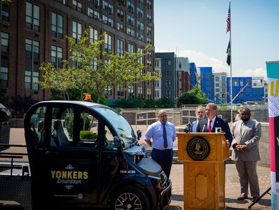 Mayor Mike Spano and other officials discuss the Yonkers