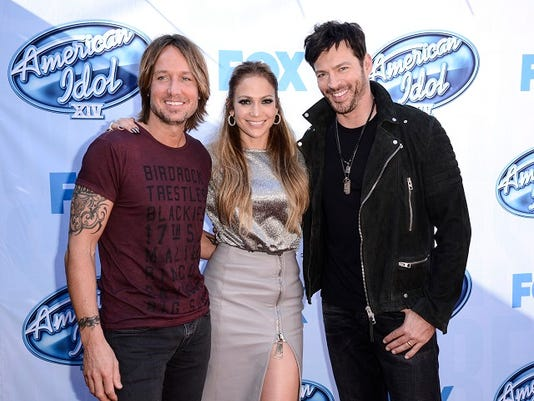 "FILE - In a  Tuesday, Dec. 9, 2014 file photo, from left to right, singer Keith Urban, singer and actress Jennifer Lopez, and singer Harry Connick, Jr. arrive on set of ""American Idol"" in Los Angeles. Fox announced announced Monday, May 11, 2015 that ""American Idol"" will go off the air after its 15th and final season next spring."