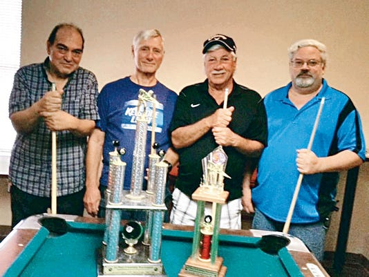 The Friendship Pool Tournament was held at the Elks on June 27. Pictured, left to right, are Danny Lujan and Ski Ramussen from the Elks, who took first place, and Smitty (Dog) Smith and Doug Beard from the Eagles, who took second place.