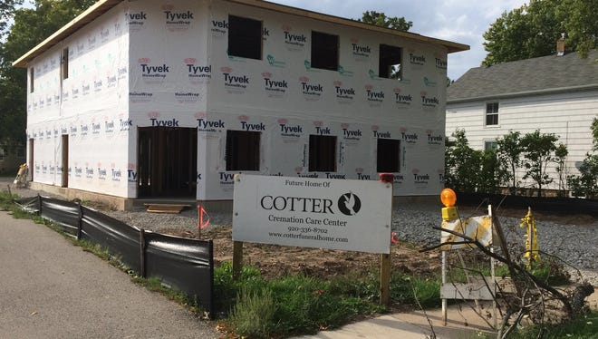 A new crematorium is being built on De Pere's east side, directly behind a gas station on George Street. Most neighbors aren't bothered by the new business, but some are surprised.