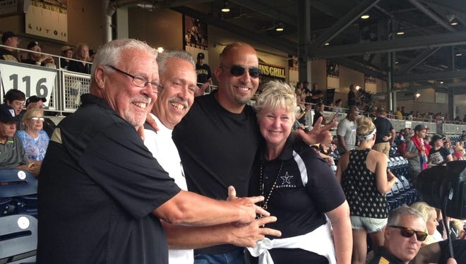 Former Vanderbilt football coach James Franklin poses with fans, including Jeff Pack (second from left) before the Commodores' game at the College World Series on Saturday.