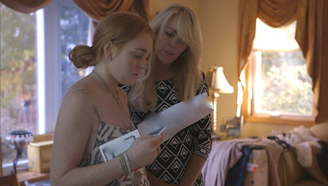 Lindsay and her mom go over her journal.