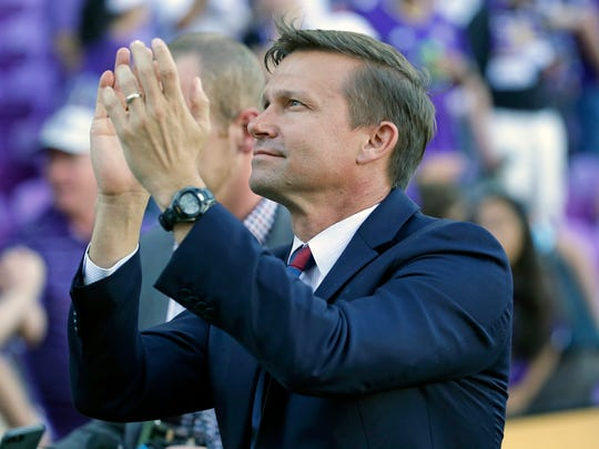 In this April 9, 2017, file photo, New York Red Bulls head coach Jesse Marsch acknowledges Red Bulls fans after an MLS soccer game against Orlando City, in Orlando, Fla.