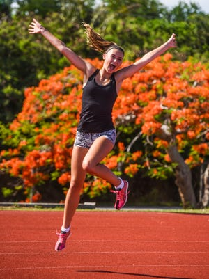 Guam High School senior Emma Mae Sheedy, 18, reveals her giddy side while on oval track at George Washington High School in Mangilao on May 24, 2018