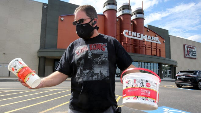 Sam Custer brought his Movie Club containers for a discount on concessions to attend a movie Friday at Cinemark Tinseltown USA.