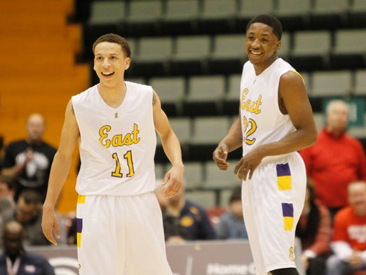 East High's Jonathon Moody, left, and Dontay Caruthers are all smiles after the two connected on a fast break basket to increase the Orientals' lead during the Class A semifinals at the Glens Falls Civic Center in Glens Falls on March 15. East won to advance to the final.