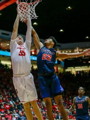 New Mexico's Connor MacDougall rises for a dunk against