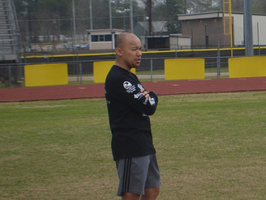 Alexandria Senior High soccer coach Sons Pathoumthong overlooks a boys practice Saturday. Pathoumthong's boys and girls' teams are in the quarterfinals of the LHSAA Division II soccer playoffs.
