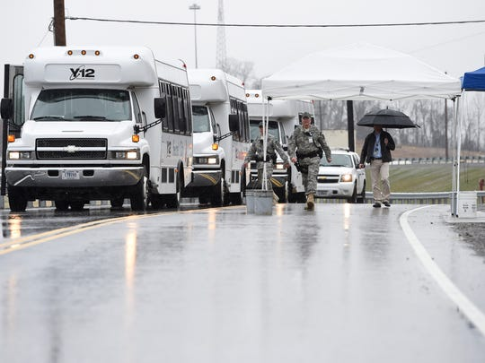 Tour buses prepare to leave following a ribbon-cutting ceremony along a newly completed road at Y-12 in Oak Ridge on Friday, March 13, 2015. The event marked the completion of UPF site readiness work, including a Bear Creek Road extension and the creation of the haul road at Y-12. (ADAM LAU/NEWS SENTINEL)