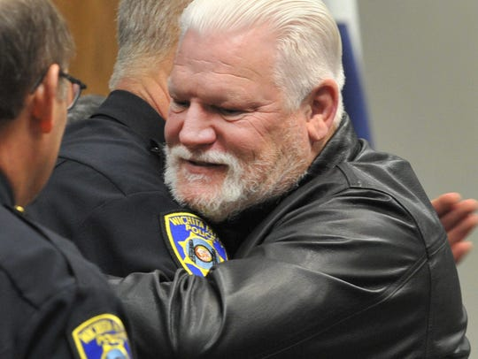 Retiring Wichita Falls police officer Paul Harper is congratulated by fellow officers at a ceremony honoring officer Harper's 36 years with WFPD Wednesday morning at the Wichita Falls Public Safety Training Center.