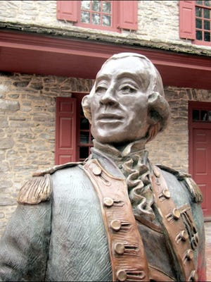In front of 157 West Market Street in York, Pennsylvania, stands this life size statue of General Marquis de Lafayette.
