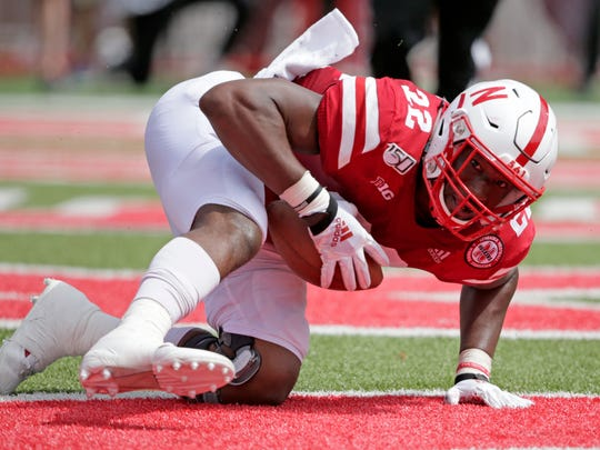 Nebraska linebacker Alex Davis (22) recovers a fumble by South Alabama quarterback Cephus Johnson for a touchdown during the second half of an NCAA college football game in Lincoln, Neb., Saturday, Aug. 31, 2019. Nebraska won 35-21. (AP Photo/Nati Harnik)