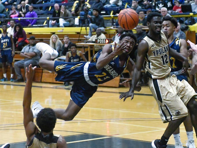 Battle Creek's KeOndre Glass (23) gets tripped up as