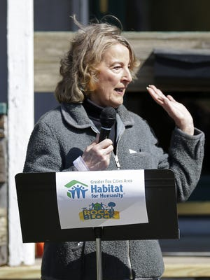 Neenah homeowner Carol Johnson speaks Wednesday during a Greater Fox Cities Area Habitat for Humanity press conference announcing a three-year Rock the Block initiative.